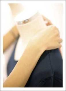 seamstress fitting a bodice neckline on a form