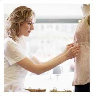 designer working on a garment on the dress form