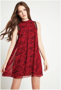 model wearing red flared dress