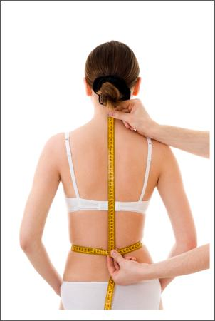 woman being measured from back neck to back waist